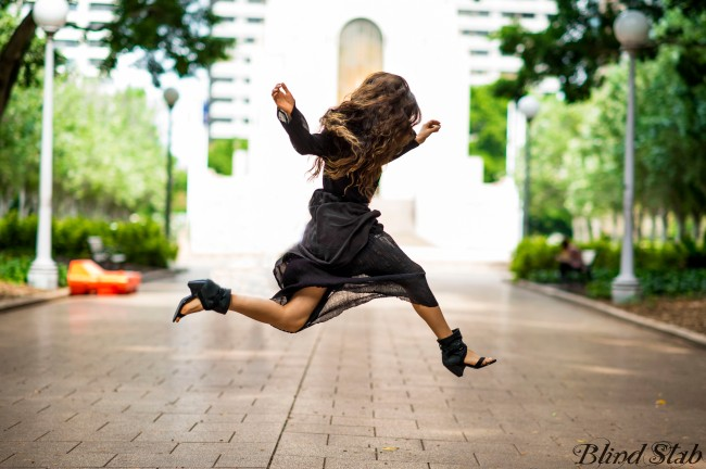 Girl-Jumping-Streetstyle-Goth-Black-Dress-Long-Hair